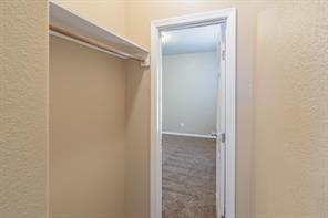 This room upstairs could be a 4th upstairs bedroom (making this home 5 bedrooms!) if this open hanging closet works for you. Otherwise, it could be an upstairs Study, craft room, YOU decide!