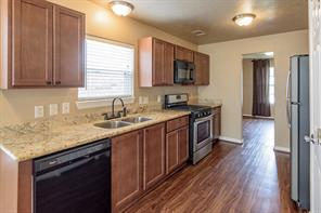 Wow! This is a very nice kitchen! And a NEW Refrigerator is included.
