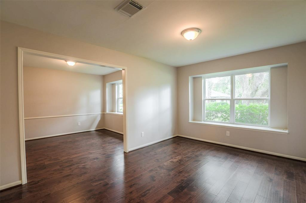 Formal living room with updated wood floors.