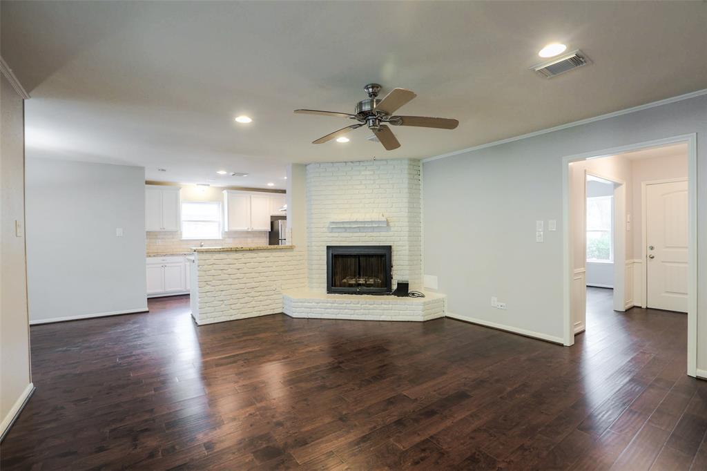 Large family room that's open to the kitchen and breakfast area.