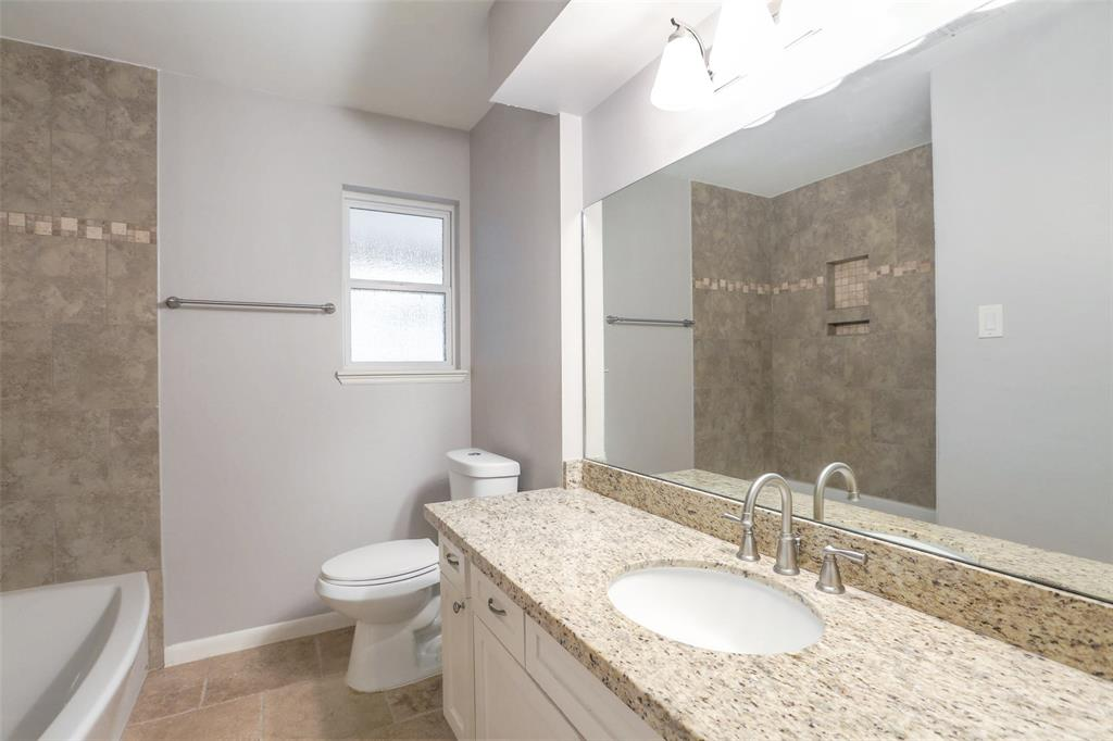 Updated full bath with granite counter top.