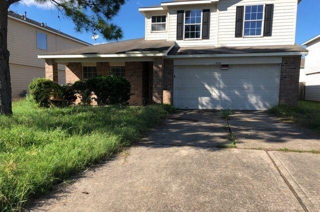 Spacious four bedroom two and half bath home in Katy ISD. Covered porch will