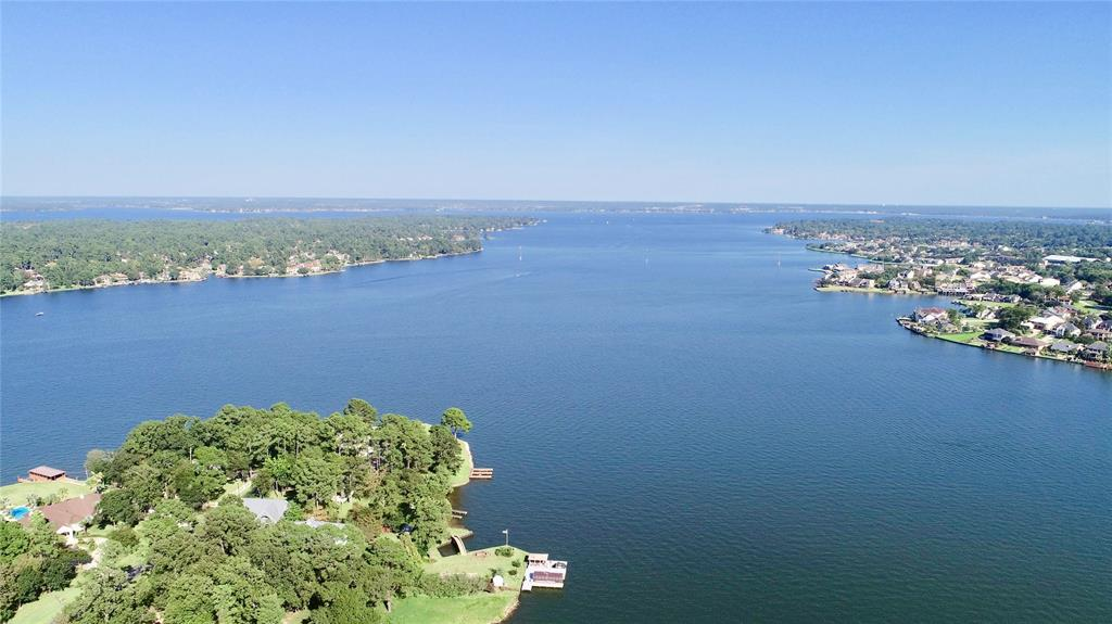 """ONE OF A KIND LOT on Lake Conroe! This lot has great views of OPEN WATER on Lake Conroe. Compare this to the canal lots looking across at other homes or so many of the """"water view"""" lots on the market where you get a peak of the lake from the second floor out of one window in a secondary bedroom through some trees. THIS IS A TRUE WATER VIEW lot of OPEN WATER on Lake Conroe. AND THAT'S NOT ALL!!! You actually have a few feet of WATER FRONTAGE with this lot as well! It's enough to LAUNCH YOUR KAYAK, CANOE, OR POSSIBLY A JET SKI! There is a boat storage and boat launch that is literally next door to this community so you can get a boat in the water there. This lot has it all at a GREAT PRICE! The lot itself is over 9k square feet, cleared, level and ready to build. Harbor Point is a great little community in MISD with low HOA fees, and a great location close to HWY 105 for all yours shopping needs. Come get this great opportunity to own Lake Conroe Waterfront property at a nice low price"""