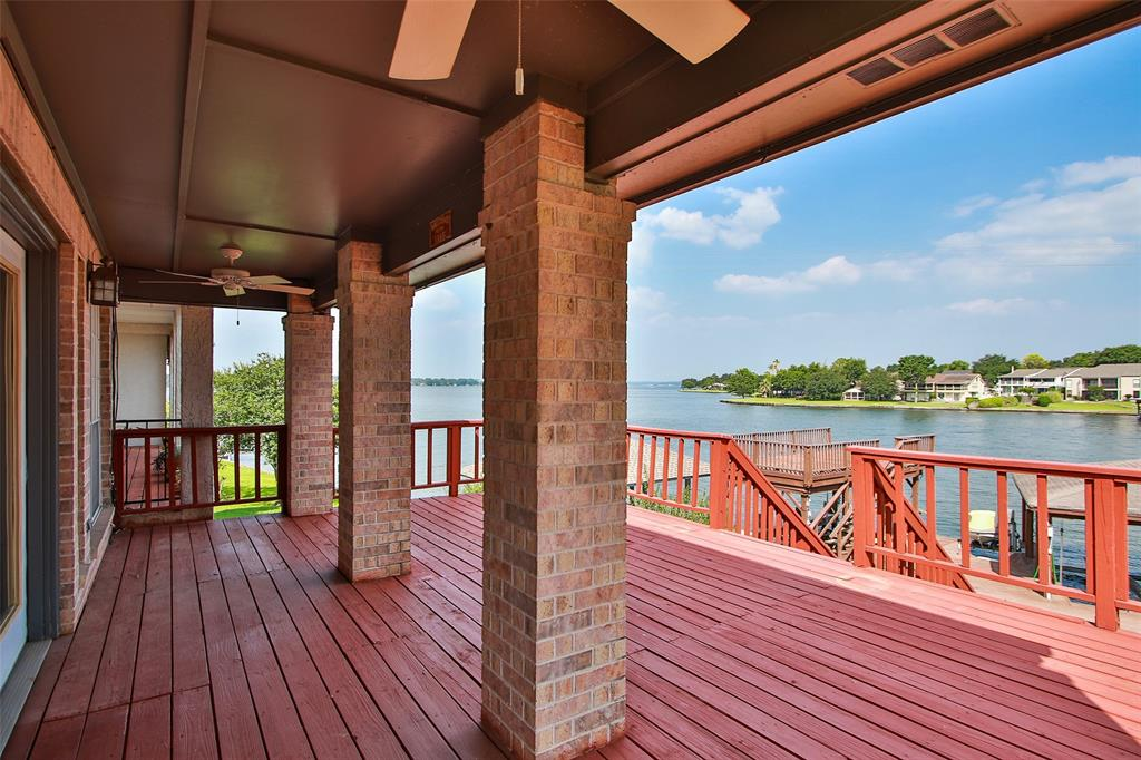 Start making memories in this beautiful lake front condo. This is a unique floor plan where kitchen, family room, dining and guest rooms are upstairs. This maximizes your views, which are stunning! Main bedroom, bath and laundry are on first level. There is a separate private deck off of the owner's retreat. The kitchen has been updated with granite counters, stainless steel appliances and white cabinets. Wood flooring flows through the main areas and owner's retreat. Carpet is in the other bedrooms. Rooms and closets are spacious. Plenty of natural light and unique spaces to relax with a book or cup of coffee (or glass of wine). It's just an all around great place to enjoy with your family and friends. Roof was replaced in May 2018. Boat house with 1 slip/lift and wave runner ramp. There is a misting system. There is also a sump pump in the courtyard area of the home which turns on automatically to improve drainage. SELLER IS MOTIVATED!