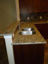 Beautiful Granite Countertops in Kitchen and Undermount Stainless Steel Sinks with Moen Plumbing Fixtures