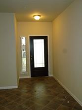 Beautiful Lead Glass Front Door and Earth Tone Ceramic Tile Flooring in Family