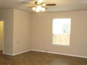 Family Room with Neutral Ceramic Tile Flooring and Ceiling Fan
