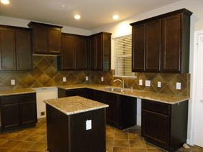 Great Cooks Kitchen with Ceramic Tiled Flooring and Center Island