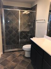 Master Bath features 5 ft. Walk-In Shower