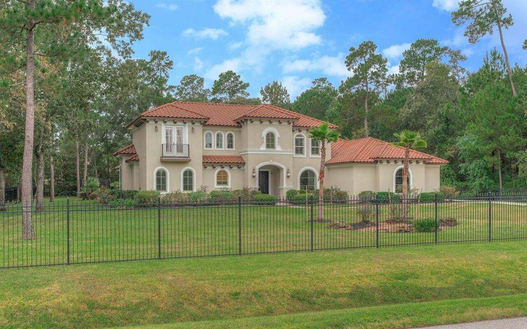 This beautiful, stately custom home offers a unique opportunity to embrace multi-generational living.  The single story guest house offers a full-size kitchen, master suite, private living room, abundant storage, and a separate entrance - all with custom features that mirror the main house (completed by this owner).  This gated estate also offers nearly 4,400 square feet of traditional family living - a master suite, with a second master down and two bedrooms upstairs - all with their exclusive bathrooms. Built by Jameson Custom Homes, this gem has elegant touches everywhere you turn - wooden beam detail in the great room, coffered ceiling focal point in the breakfast room, and a tile groin ceiling in the kitchen - to name a few.  The exterior color has been updated, along with an interior paint refresh.  There is abundant storage throughout and parking to accommodate family and/or guests. Sumptuous wood and travertine flooring. Features to check off all of your boxes.