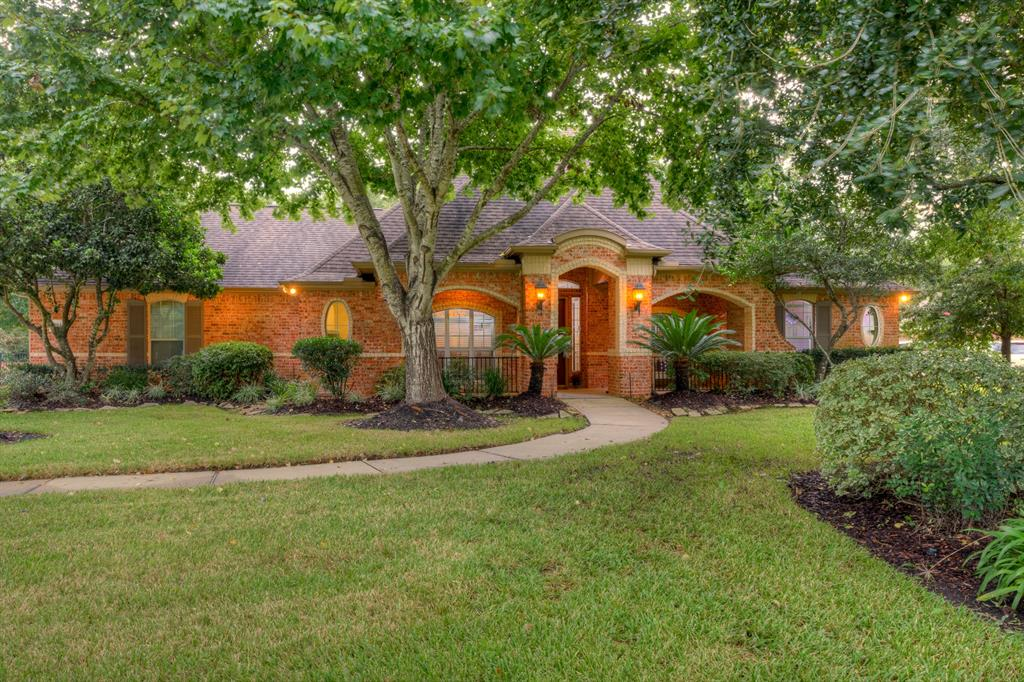AMAZING 1.5 story custom home with sparkling pool nestled among the trees in highly desired Bender's Landing! Super location-easy access to Grand Parkway, Hardy Tollway, I-45! This wonderfully maintained 4/5 bedroom/4 full bath home w/ study, formal dining, game room &  large 3 car garage home features an open floor plan. Soaring ceilings and recent wood tile floors sweep you in! The island kitchen features granite, custom cabinets, SS appliances-lots of counter & cabinet space! Relax around the cozy gas log fireplace! Private master retreat features sitting area overlooking the parklike backyard. Master bath has a  large walk-in shower with seamless glass & wonderful jetted tub, dual sinks & walk-in closet! All secondary bedroom are spacious w/ walk-in closets! Upstairs is a great game room with a full bathroom w/ LOTS of storage! Super backyard with pool and LOTS of space to play! Low Taxes! Zoned to highly desired Conroe ISD schools! Close to Woodlands shopping & the Exxon campus!