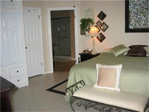Master Bedroom with well-designed built in storage system.