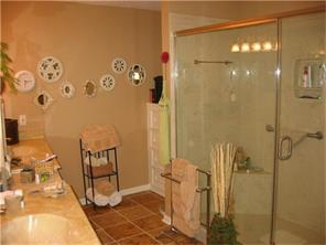 Master Bathroom with HUGE walk-in Shower that has built in shelf and seat.