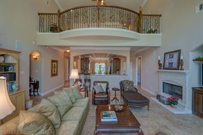 Another view of the Family Room which is open to the Kitchen.  The upstairs 15x14 flex space with wrought iron railing overlooks the Family Room.