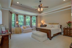 The very generous sized 20x18 Master Bedroom features a bay window sitting area with coffered ceiling.