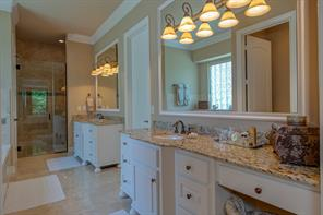 "The Master Bath features custom cabinetry, granite counters, dual sinks, travertine flooring, a separate jetted tub and an awesome 54""x48"" 10 foot shower!"