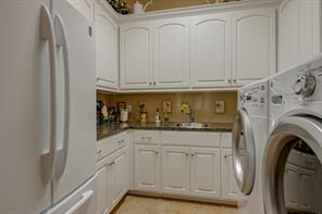 What a Laundry Room!  You'll find lots of additional storage and plenty of counter space here!