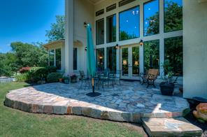 Real Elevation with flagstone patio.