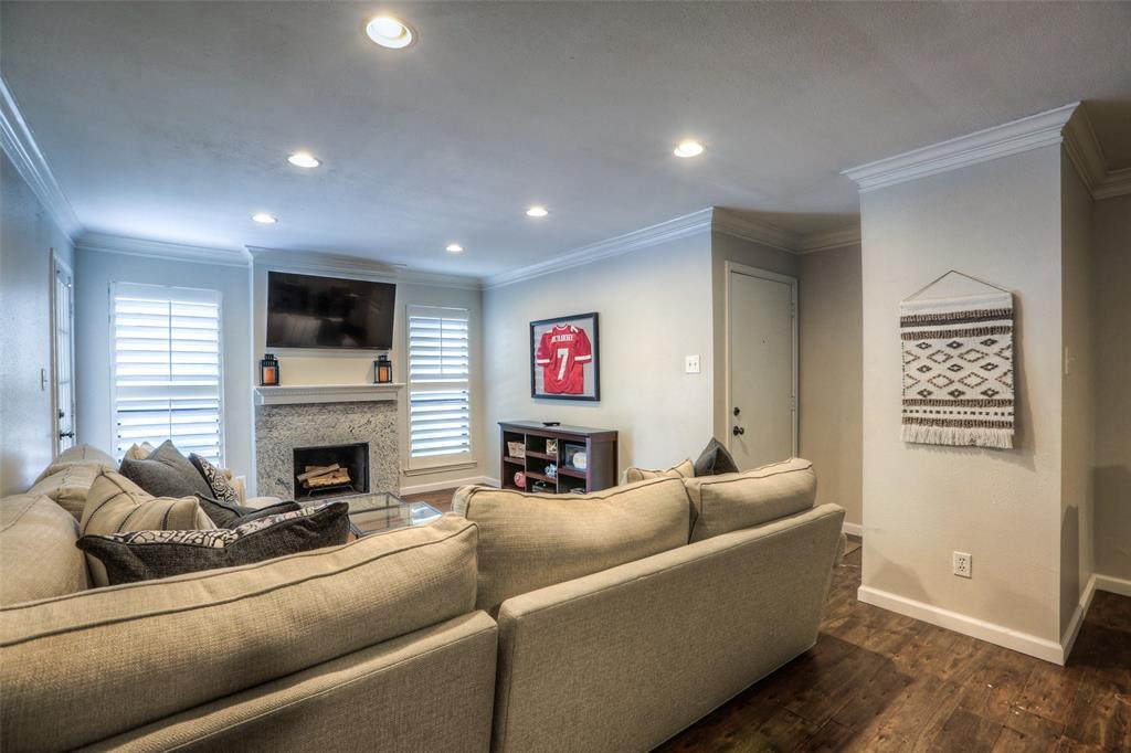 Living areas feature wood floors, crown molding and recessed lights.