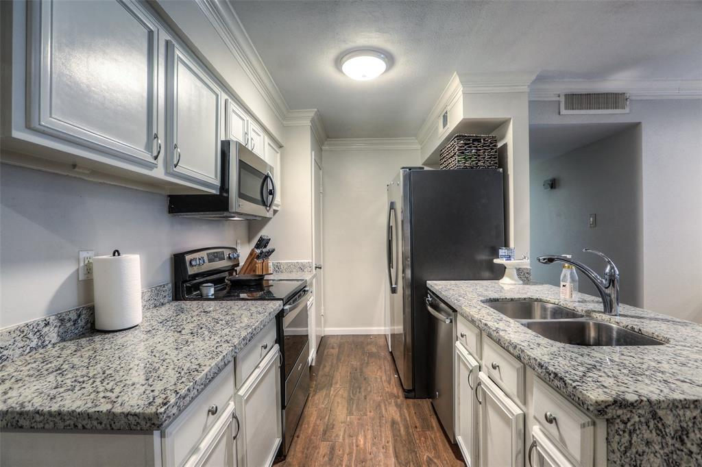 The kitchen features granite counter tops and recently installed stainless steel appliances.