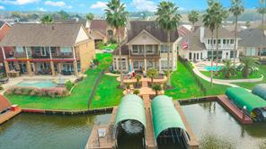 Beautiful aerial view of this gorgeous home looking at the large patio area, excellent for entertaining.