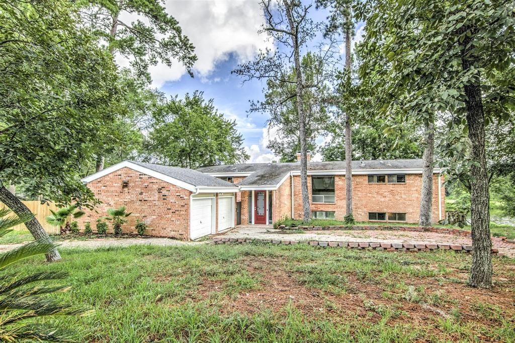 Wonderfully remodeled home complete with new flooring, paint, and luxury water living on Forrest Hills Lake! Come by and check out this two story home with fun floorplan and close to all the fun that Conroe offers for family and friend entertainment. Home did take on some water during Harvey, but home has been renovated and ready for a new buyer! Plenty of rest, relaxation, and fun at 417 Brook Hollow!