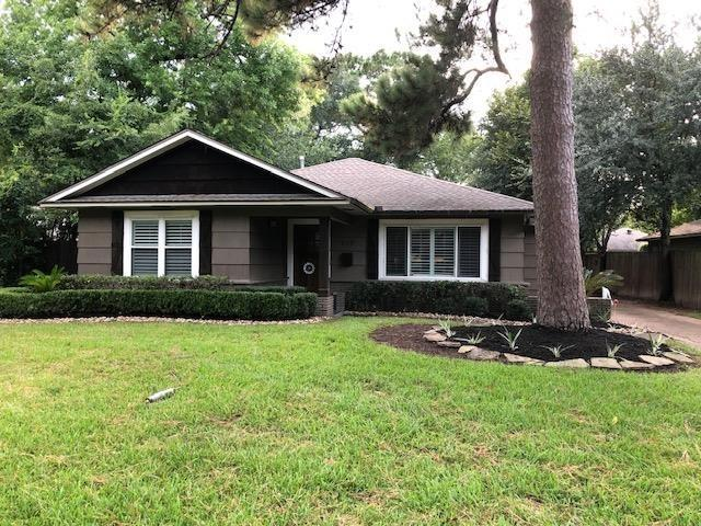 Recently updated and enlarged. Not like most of the homes in the neighborhood. Great big kitchen and living areas. Kitchen boasts breakfast bar, under cabinet lighting, granite, stone backsplash, beautiful cabinetry. Access to backyard through living area. Smaller bedroom off master - perfect for study/office/nursery. Master closet is walk in. Master has french doors leading to back patio and yard. Master bath has double sinks, tub and separate shower. Decent size bedrooms, all with nice closets. Utility room in house. Refrigerator, washer/dryer all stay! Yard work is done for you - how much better can you get! Automatic driveway gate. Good credit required.