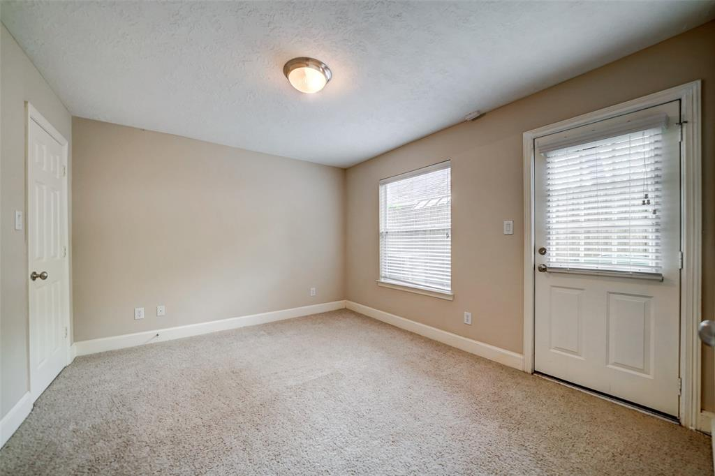 This generous downstairs bedroom is a perfect spot for guests, workout room, or a home study.