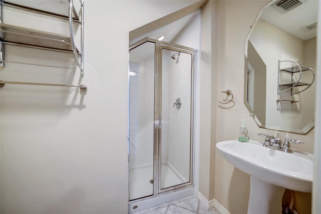 The downstairs bedroom has its own en suite complete with stand-up shower.