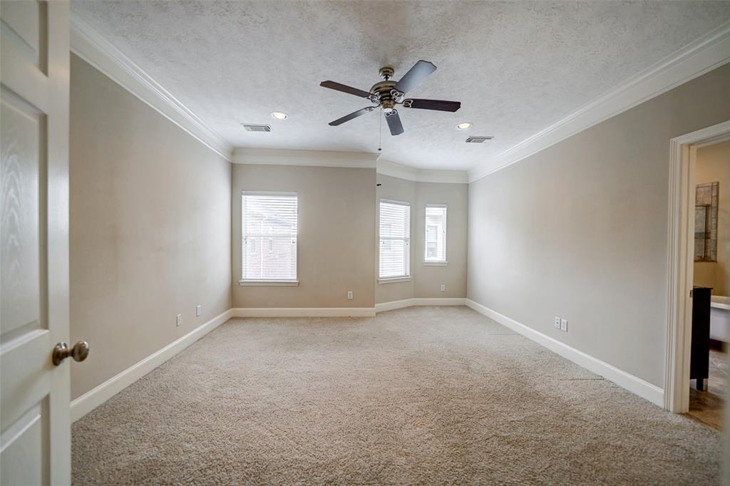 The master bedrooms is large.  It also includes recessed lighting and a ceiling fan.