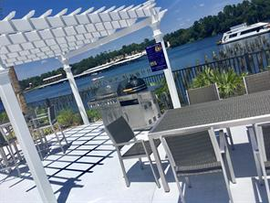 Enjoy and entertain guest with 3 poolside grilling stations with ample seating and all lakeside.