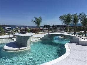 The two resort-style pools overlook Lake Conroe and are surrounded by tropical vegetation, bubbling waterfalls, a peaceful arched bridge and have ample seating for you and your guest.