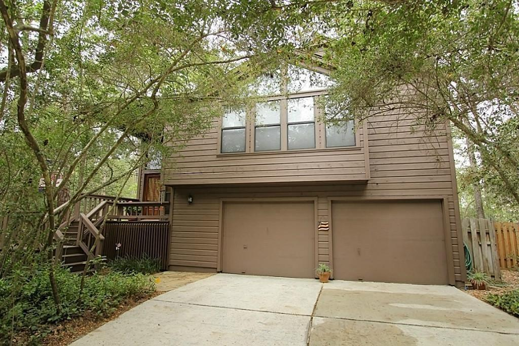 Unique Life Forms home in the heart of the Woodlands. This turn key rental home provides a peaceful setting among the trees of Forest Ridge neighborhood. The floor plan is very open with main living area and master suite upstairs & 2 bedrooms and den downstairs. If you are a bird watcher, you will enjoy the screened balcony upstairs Many updates include tankless water heater, double pane windows, water filtration system, AC & roof replaced in 2012. READY FOR MOVE IN 11-1!