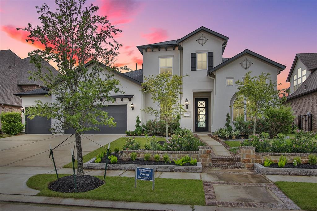 Beautiful stucco home blends contemporary flair with sophistication as it embraces clean lines and subtle architectural purity. Built by American Luxury Home Builders, Toll Brothers, this quality-laden residence is nestled against professionally landscaped grounds where stone and brick patterned walkway heighten its stellar curb appeal. Towering entry is anchored by wide plank hardwood floor & massive rich millwork. Light-filled interior is backdrop for study, family room w/LED fireplace, sunken wine room, double crown molding, substantial blocked wainscoting & distinctively sheik staircase. Walls of windows showcase view of scenic lake, sheltered patio and loggia. Expansive gathering kitchen features marble counter tops, enormous island, state-of-the art Jenn Air appliances and towering glass- front lighted cabinets. Magazine-worthy master engulfed in soothing gray block paneling complete with luxurious marble bath. 4 BR, 4 ½ baths, game room, media room, office, 3 car garage.