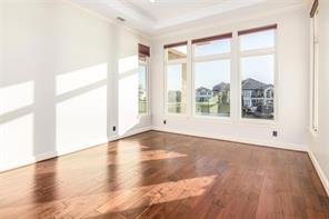 Full view of the open family/living, kitchen, breakfast/dining area on the second floor. Lots of windows. Automated honeycomb window shades in every window to enjoy this breathtaking view of the lake and the beautiful neighborhood. Custom wood floors throughout!!