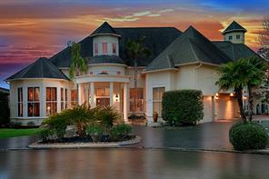 Custom stucco home built on a 16,000 sq ft pie shaped lot with 180' of waterfront.