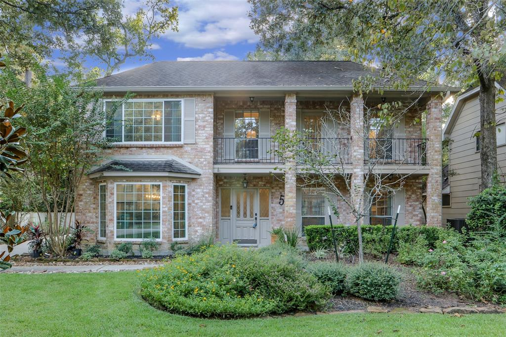Beautifully updated traditional home located in The Woodlands Village of Panther Creek. Great location close to dining, shopping, entertainment, schools, medical & all of the amenities The Woodlands has to offer. Gorgeous curb appeal w/ lush landscaping, covered front porch & balcony, & long driveway. Spacious backyard w/ huge covered patio w/ stained wood ceiling, fan, & wired for tv perfect for entertaining! The first floor features gorgeous hardwood flooring, custom woodwork, formal dining room, huge family room w/ brick fireplace & built-ins open to kitchen & breakfast, bright kitchen w/ granite countertops & lots of cabinets, breakfast room, & large utility room w/ storage. The upstairs features a large master bedroom w/ balcony, custom millwork & data area & remodeled master bath w/ dual sinks & granite countertops, three spacious secondary bedrooms and remodeled bathroom. A must see!