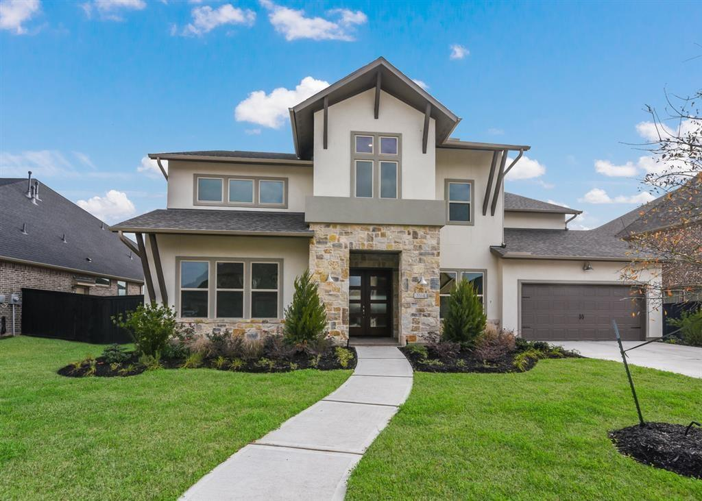 MLS# 8135071 - Built by Darling Homes. Ready Now! ~ Gorgeous Modern Elevation with Stucco, Stone and a Double Door Entry.  The 7449 floor plan exemplifies open-concept living and is perfect for entertaining on both floors!  Mingle with friends and family in the main living and enjoy views of your covered outdoor living area. This home has a kitchen and a Spice Kitchen that you'll love whether you're entertaining or having a relaxing evening at home.  Beautiful dramatic curved staircase will take you upstairs where the other 3 bedrooms, Media Room and Game room are located.  The outdoor patio is set up for an outdoor kitchen. Call today to schedule your personal tour.  Just be prepared to fall in love!!