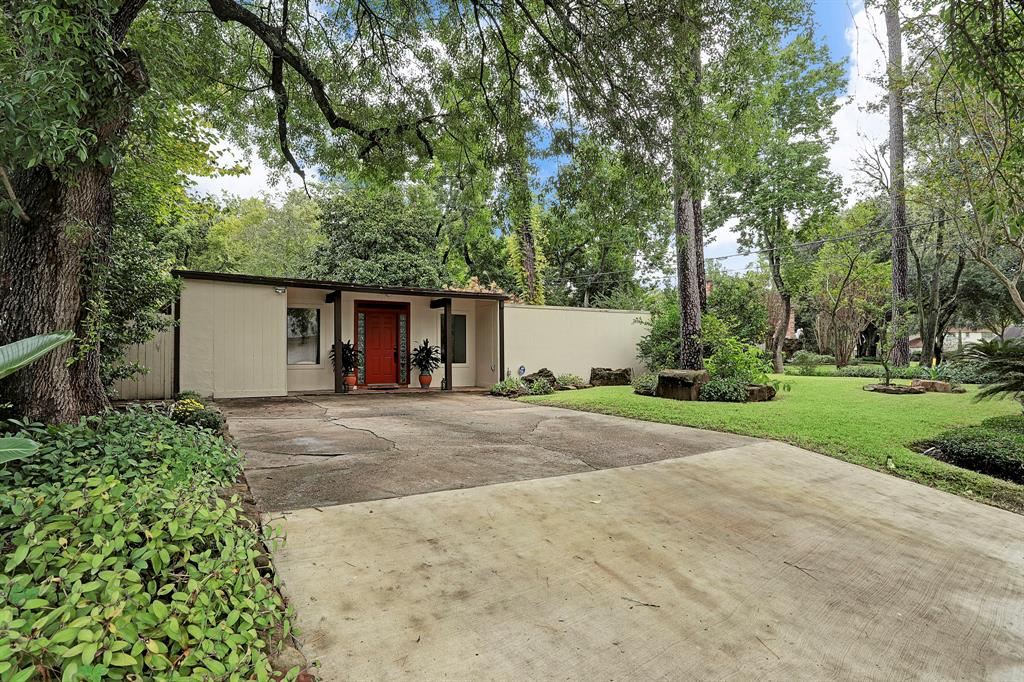 SELLING AS IS. DID NOT FLOOD. This house is on a large, beautiful ravine lot that would be perfect for a new home. Zoned to sought after Spring Branch ISD schools, this contemporary home is an open concept with glass doors throughout. Laminate flooring/tiles. Kitchen features granite countertops and the refrigerator is included.  Room sizes are approximate.