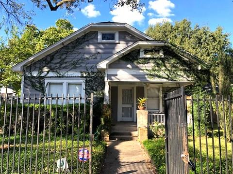 "CUTE AS A BUTTON!! and right in the middle of it all! Live the ""Heights"" lifestyle in this charming Craftsman style bungalow boasting all the modern conveniences and also in walking distance to hip restaurants, bars, jogging and bike trails … you name it! Home is completely fenced with ample yard space. Shared use (with Landlord) of a large outdoor shed for additional storage! 2 good size bedrooms and attached bathrooms offer a great layout for a  or pair of roommates! Living, dining, and kitchen in a partially open plan that is great for entertaining! Warm, recently refinished wood floors add a polished glow to everything! Gas stove, dishwasher, refrigerator, washer, and dryer … everything you need! Wonderfully picturesque front porch (with a ceiling fan and light) for lazy Sundays watching life go by! This IS the Heights bungalow you are looking to rent!"