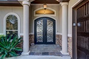 Ornamental iron doors have glass panels that can be opened independently from the doors to allow airflow on those gorgeous days!