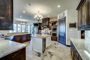 The expansive kitchen offers an abundance of storage and counter space.