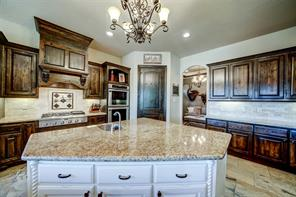Note the double ovens, Thermadore gas cooktop and corner walk-in pantry.