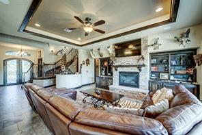 Gas fireplace is surrounded by custom built-ins.
