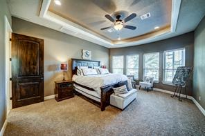 The master suite overlooks the pool with views to Lake Conroe.