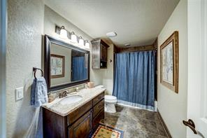The second full bath is accessible from the game room and the second bedroom.
