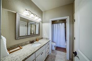 The third full bath is a Hollywood style bathroom in between the 3rd and 4th bedrooms.