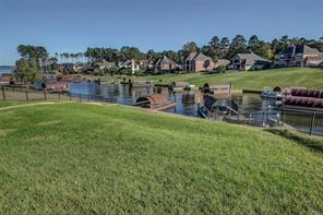 Spacious backyard is already fenced.  Access Lake Conroe from your private boat slip!