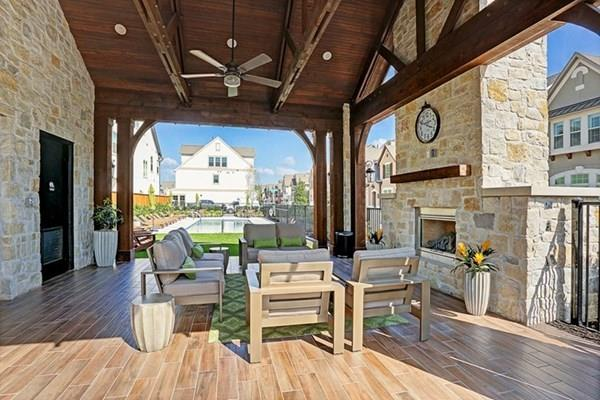 "Have it ALL in this gated, recent construction - centrally located in Houston - so close to everything!  This City Home in Village at Spring Branch enjoys large open concept living with high volume ceilings for today's lifestyles.   Decor is crisp and rooms are flooded with light.  First floor bedroom suite could be home office, opens to private fenced back yard with pavered patio for outdoor enjoyment or place for pets.  Second level features large open living, dining and kitchen.  Large eat-in island kitchen, granite counters, stainless appliances.  Walk-in pantry and bar with wine racks, powder bath.  Third level has spacious king sized master suite, secondary bedroom suite, utility room and hall ""study"" space.  Master bath with oversized super shower and generous walk in closet.  The complex has a community pool and play area pavilion.  Gated for your new lock and leave lifestyle.  Supported by SBISD schools, Memorial High.  Dynamically located near the ReImagine Longpoint project."
