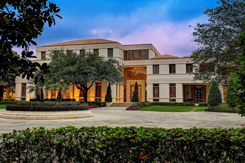 Situated on a gated 3+ acre bayou lot in River Oaks, this residence accommodates a luxurious lifestyle for everyday living, entertaining, and professional requirements. Anchored by the enormous, triple-height, marble and glass reception hall, the first floor encompasses the elegant formal living and dining salons for well more than 200 guests; a professional-grade, eat-in kitchen extensively equipped to service household gatherings or entertainment of any size. Positioned on the second floor, the sumptuous master suite offers the luxuries of space and privacy with a pair of serene bedrooms served by two full magnificently appointed full baths; bespoke dressing areas; lavish, custom fitted closets; a fitness center/beauty salon; and two balconies. Additions include a resort-style pool, spa, and fully equipped entertaining cabana, a separate summer kitchen with pizza oven and bar; a gazebo with commercial hibachi grill and exceptional children's play areas.